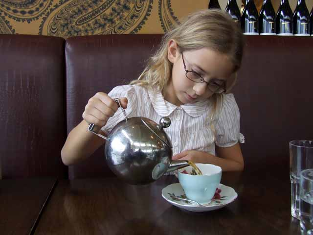 Beth Anne shows off her skills honed over years of pouring tea for stuffed animals.